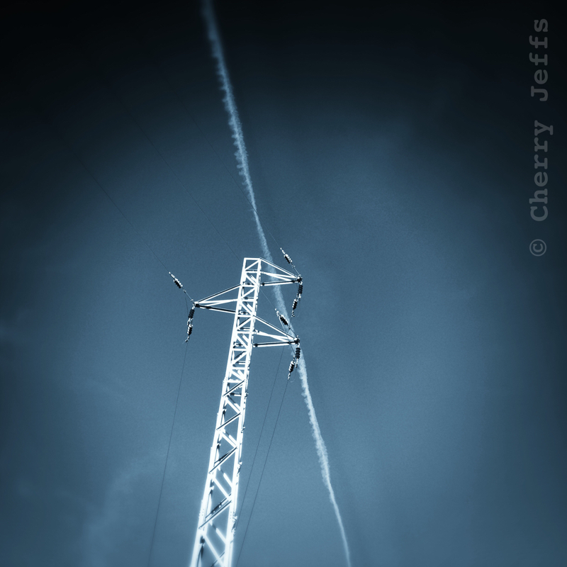 Telegraph pole against sky with airplane trail - Andalusia, Spain. © Cherry Jeffs 2014